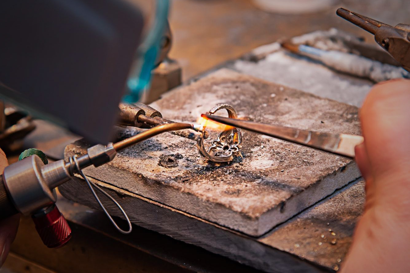 Close up of a ring being repaired with a blow torch